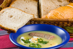 Traditional polish white borscht with eggs and sausage Stock Photography