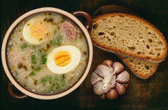 Traditional polish white borscht - zurek, sour soup with white sausages and eggs. Stock Photography