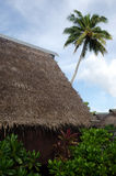 Traditional Polynesian houses in Aitutaki Lagoon Cook Islands Stock Photo