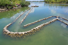 Traditional Polynesian old fish trap with stones Stock Photography