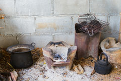 Traditional poor thai kitchen with old kitchenware. Royalty Free Stock Images