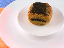 Traditional poppy-seed cake on white plate Stock Image