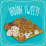 Traditional popular sweets of Indian cuisine. Traditional food, popular sweets of Indian cuisine, pretzels Jalebi or Zulbia, balls Laddu or Laddoo and Royalty Free Stock Photos