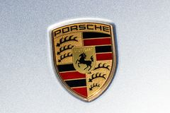 Indianapolis - Circa March 2018: Traditional Porsche Crest with the horse of the Stuttgart coat of arms on a new Cayenne II. Traditional Porsche Crest with the Stock Images