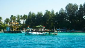 A traditional port harbor with blue sea and green tree on the beach. In karimun jawa island stock photography