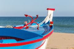 Traditional Portuguese boat on the beach. Royalty Free Stock Image