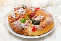 Traditional portuguese Chrismas cake Bolo rei. On dish on white wooden background Stock Images