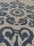 Traditional Portuguese cobblestone pattern in Lisbon Portugal.  royalty free stock image