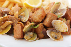 Traditional portuguese dish -clams with pork meat Stock Photography