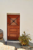 Traditional portuguese door on white wall in monsaraz Stock Images