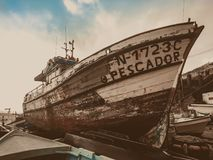 A traditional Portuguese fishing boat on land stock image