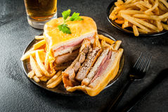 Traditional Portuguese food, francesinha. Traditional Portuguese snack food. Francesinha sandwich of bread, cheese, pork, ham, sausages, with tomato beer sauce stock photos