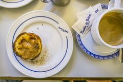 Traditional portuguese pastry and coffee in famous Pasteis de Be. Lisbon, Portugal - January 31, 2018: Traditional portuguese pastry and coffee served in famous Stock Image