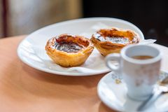 Traditional Portuguese pastry and coffee Stock Images