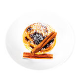 Traditional portuguese pastry - Pastel de nata with curstard cream. And sugar powder on a white plate isolated on white macro Royalty Free Stock Photo