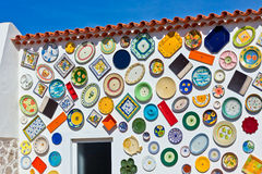 Traditional portuguese pottery plates on a wall Stock Photography