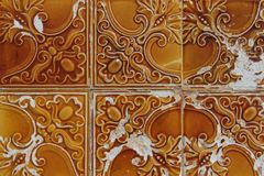 Traditional portuguese tiles named azulejos. Orange traditional portuguese tiles named azulejos royalty free stock photos
