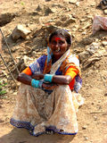 Traditional Pose. An old Indian woman sitting Stock Images