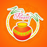 Traditional pot and sugarcane for Happy Pongal celebrations. Stock Photos