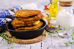 Traditional potato pancakes. With sour cream. Selective focus Royalty Free Stock Photos