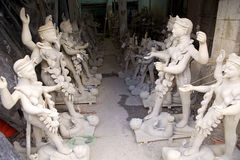Traditional pottery in Kumortuli, Kolkata, India. Clay idols of Hindu Gods in a pottery workshop in Kumortuli, the traditional potters' quarter in nothern Royalty Free Stock Photos