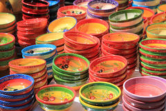 Traditional pottery on a market in the Provence. Pottery in many bright colors on a local market in the Provence, France Stock Image