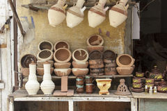 Traditional pottery in market small shop,Egypt. Small pottery in traditional market ,Egypt Royalty Free Stock Images