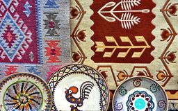 Traditional pottery and rugs. Traditional colored ceramics and rugs in Horezu, Romania stock photography