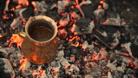 Traditional process boil Turkish coffee on coals. stock video