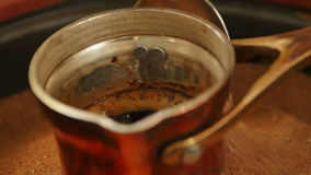 Traditional process boil Turkish coffee in turk stock video