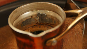 Traditional process boil Turkish coffee in turk Royalty Free Stock Image