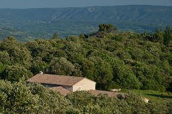 Traditional Provencal house under Luberon mountains Royalty Free Stock Photo