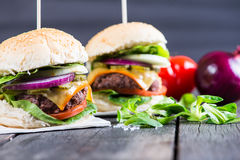 Traditional pub style burger  on wooden table Royalty Free Stock Photos