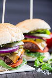 Traditional pub style burger  on wooden table Stock Photo