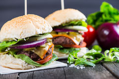 Traditional pub style burger  on wooden table Stock Image