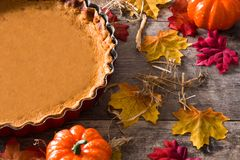 Traditional pumpkin pie for Thanksgiving. With autumn decoration. Copyspace royalty free stock photo