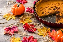 Traditional pumpkin pie for Thanksgiving on wooden table. Copyspace stock photography