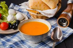 Traditional pumpkin soup, homemade with bread stock photos