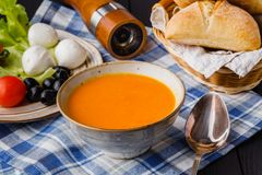 Traditional pumpkin soup, homemade with bread royalty free stock photos
