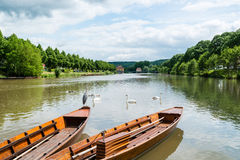 Traditional punt boats in Tubingen aka Tuebingen. Traditional punt boats are waiting for tourists as passengers at the waterfront of Tubingen (Tuebingen) in the Stock Image