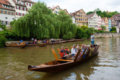Traditional punt in front of the waterfront of Royalty Free Stock Photo