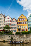 Traditional punt in front of the waterfront of. Tubingen, Germany - May 17,2015: A traditional punt is passing the beautiful waterfront of Tubingen (Tuebingen) Royalty Free Stock Photos