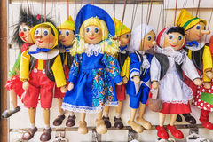 Traditional puppets made of wood. Shop in Prague Stock Images