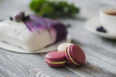 Traditional purple berry cake and macarons souffle dessert and almond dacquoise, raspberry confit, crispy layer with Stock Photo