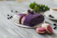 Traditional purple berry cake and macarons souffle dessert and almond dacquoise, raspberry confit, crispy layer with Royalty Free Stock Photography