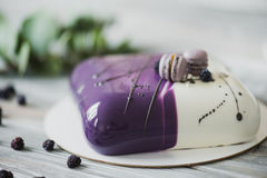 Traditional purple berry cake and macarons souffle dessert and almond dacquoise, raspberry confit, crispy layer with Stock Photos