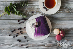 Traditional purple berry cake and macarons souffle dessert and almond dacquoise, raspberry confit, crispy layer with Royalty Free Stock Images