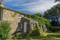 Traditional quaint cottage in a village in England stock image