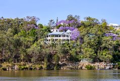 Traditional Queenslander House on the banks of river in Queensland Australia. A traditional Queenslander House on the banks of river in Queensland Australia Royalty Free Stock Photo
