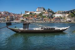 Traditional Rabelo Boat on the Bank of the River Douro and Colorful Facades of Typical Houses- Porto, Portugal Stock Images